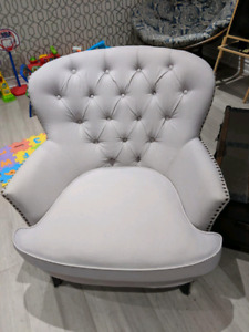 Pair of tufted arm chairs