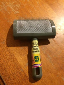 .50 cents cat/small dog brush