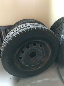 4 studded winter  tires in excellent condition on Rims225/70 R16