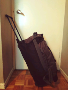 Duffel bag with wheels and handle