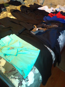 Lot of men's dress shirts and pants