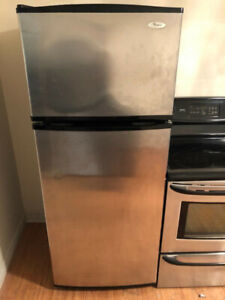 "Whirlpool stainless steel apartment size 28""w28""d67""h fridge"
