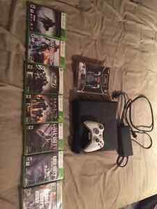 Xbox 360 in good condition with lots of games