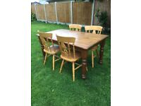 Good solid farmhouse waxed pine table and 4 chairs