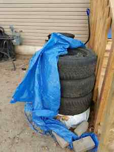 205 55 r 16 winter tires W/ rims $130 for set.