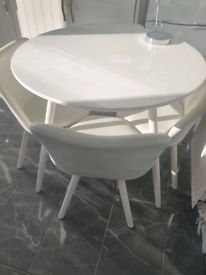 Small white table and chairs