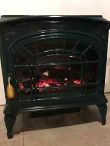 "Electric fireplace / stove, ""Heat-N-Glo"""