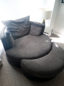 Snuggle chair with foot stool.