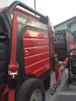 Honda EU6500IS generator with warranty and cover