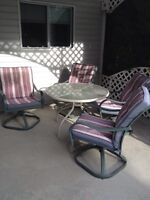 Free round side table when you purchase this patio set!!