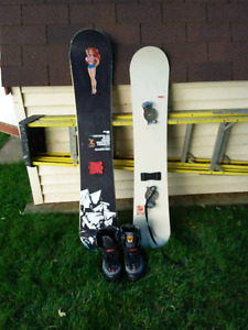 2 snowboards and boots,