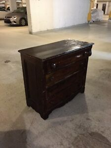 century old wood  dresser. wonderful piece of dated furniture