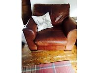 Large leather sofa and arm chair . Heavy duty leather sofa fashionable worn look .