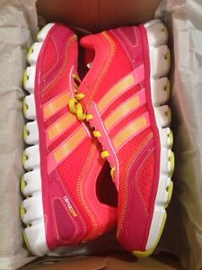 Pink and yellow adidas running shoe size 9.5