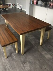 Wooden table with benches