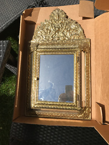 Antique mirror with shoe shine kit