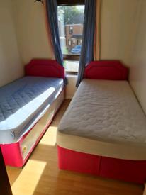 2 pink kids single beds