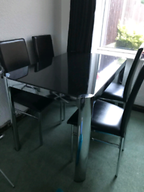 Black glass dining table and 4 chairs