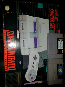 Super Nintendo complete on box with games