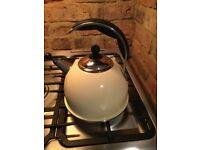 AGA stainless steel whistling kettle in cream