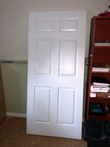 "36""x 80"" solid core doors. Never used. $200.each OBO"