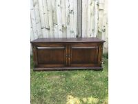 Solid oak and very heavy oak tv unit in very good condition hand made by Rushworths in Shrewsbury