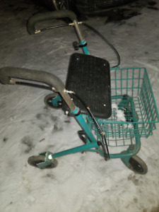 Foldable Green Rolling Walker with Basket in Good Condition