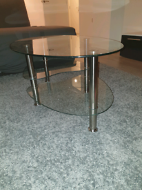 Oval glass coffee table with chrome
