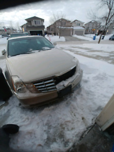 2007 Cadillac DTS front end damage, write off easy fix.