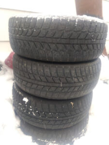 Set of four 195/60/14 winter tires on rims(4x100)
