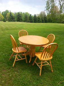 Solid wooden table and four chairs