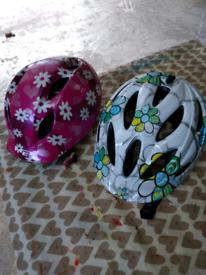 Couple of kids cycling helmets