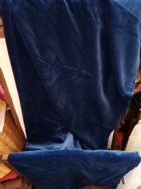 A pair of blue velvet curtains