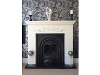 Cream fire surround, cast iron fireplace, granite hearth