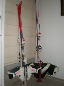 2 pair of skis and boots and poles