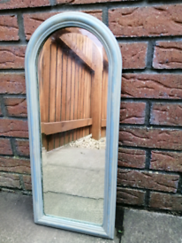 Antique bevelled glass arch top mirror