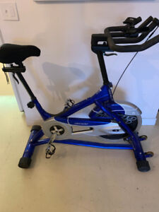 Giant Exercise Bike W/ 2 Pairs of Clip-in Shoes
