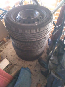 4 - 205 55 R16 Goodyear tires on rims.
