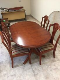 Extending Yew dining table with four chairs
