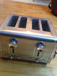 Bella red and stainless toaster was 75.00 plus tax only 25.00 l