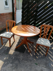 Drop leaf oval table