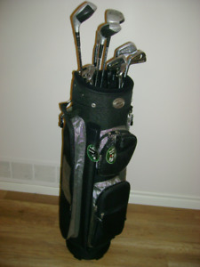 NEW GOLF BAG, AND  10 USED CLUBS, PLUS
