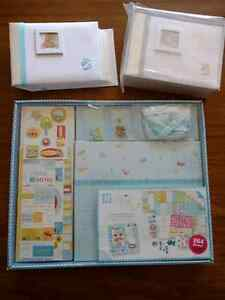 Baby boy scrapbook album and 2 picture albums.