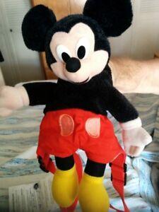 Deux Mini Sac a dos un Mickey Mouse et l'autre en cuir noir