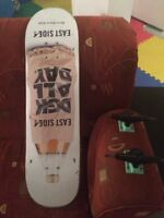 Selling a skateboard deck, two industrial trucks, and rail.