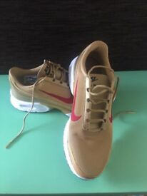Gold Nike Air Size 6. As new.