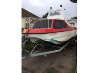 17ft fishing boat with a Mercury 50hp engine in full working order with radio and lots of extras