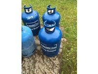 4 empty calor gas cylinders