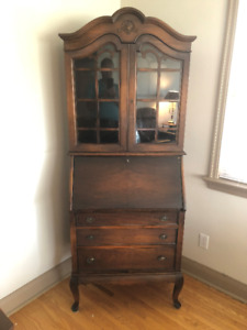 Antique secretary desk with glass enclosed shelves