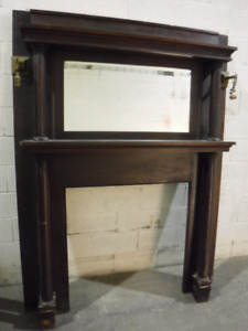 Fireplace mantel. Wood with mirror, columns and lights